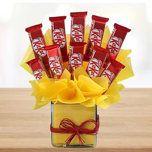 Remarkable Arrangement of Kitkat Chocolates in Glass Vase