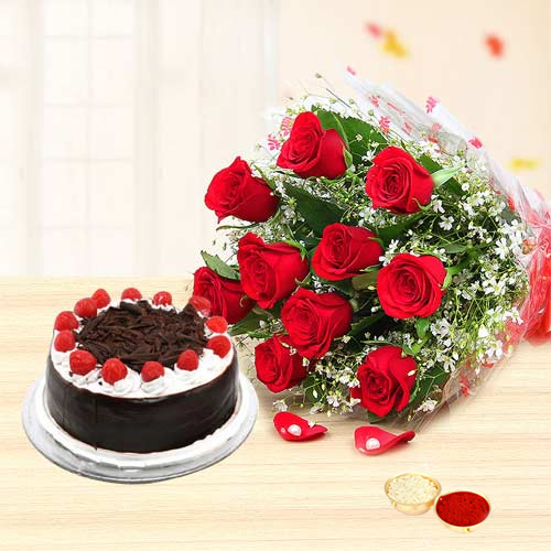 Charming Red Roses along with delicious Black Forest Cake with free Roli Tilak and Chawal