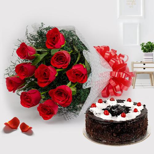 Elegant Black Forest Cake Glazed in Cream and Cluster of Red Roses