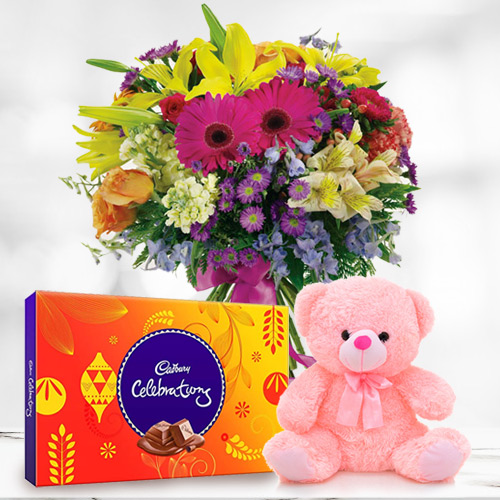 Brilliantly Arranged Mixed Flower in a Vase with Small Teddy and Cadbury Celebration Chocolates