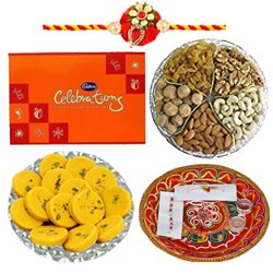 Lovely Brotherly Love Gift of Cadbury Celebration Chocolate Pack, Mixed Dry Fruits, Haldiram Kesar Peda, Shree Thali and 1 Trendy Zardoji Rakhi with Free Roli Tika and Chawal